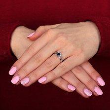 Серебряное кольцо Волшебная петля с синтезированным сапфиром и фианитами