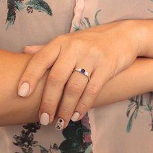Серебряное кольцо Танита с синтезированным сапфиром и фианитами
