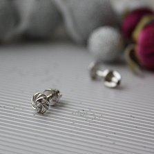 Золотые серьги-пуссеты Завиток в белом золоте с бриллиантами