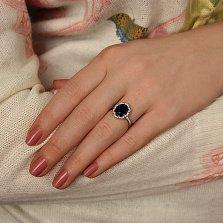 Серебряное кольцо Цирцея с ювелирным кристаллом цвета сапфира и фианитами