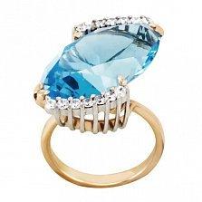 Золотое кольцо Катарина в комбинированном цвете с голубым топазом и фианитами