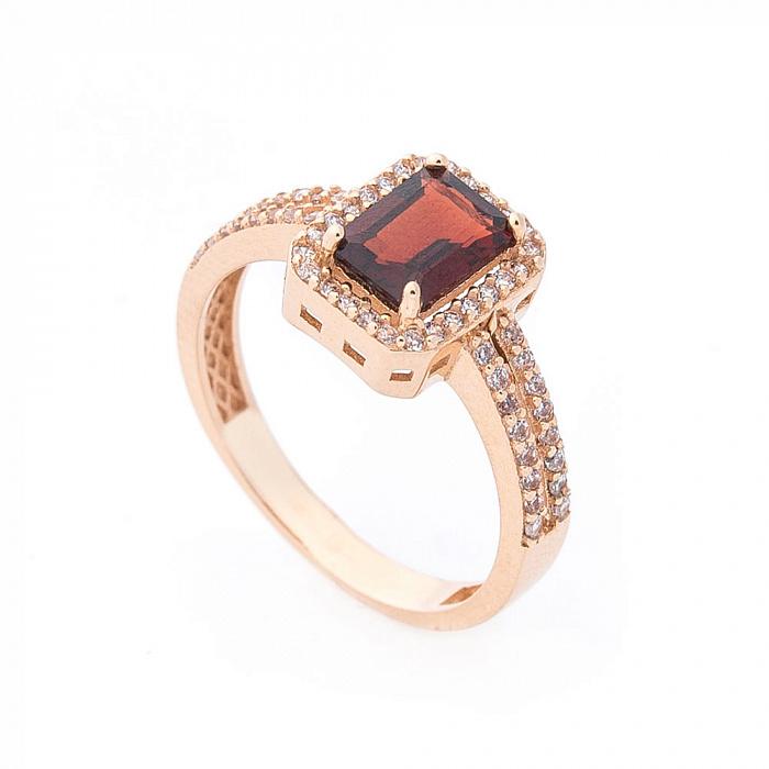 Золотое кольцо Шарлотта с гранатом и дорожками фианитов на шинке 000082345