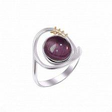 Серебряное кольцо Намек с фиолетовым улекситом (кошачьим глазом) и золотой вставкой