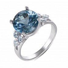 Кольцо из белого золота с голубым топазом и фианитами 000134835