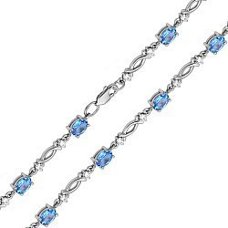 Браслет из белого золота с голубыми топазами и фианитами с родированием 000131631