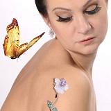 Золотая брошь с бриллиантами и изумрудами Орхидея