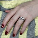 Серебряное кольцо Волшебное перышко с синим и белыми фианитами
