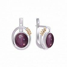 Серебряные серьги Намек с фиолетовым улекситом (кошачьим глазом) и золотой вставкой