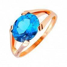 Кольцо из красного золота Тициана с синим топазом лондон