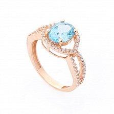 Золотое кольцо Аделфа с голубым топазом и белыми фианитами