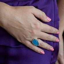 Золотое кольцо Женева с голубым ониксом и фианитами