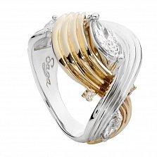 Серебряное кольцо с фианитами и золотой вставкой Лирния