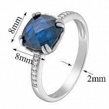 Золотое кольцо Аделаида в белом цвете с темно-голубым топазом и фианитами
